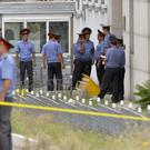 Police outside the Chinese embassy in Bishkek after a suspected suicide bombing (AP)