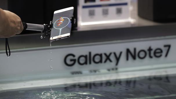 A man tries out Samsung's Galaxy Note 7 smartphone at a shopping mall in Beijing (AP)