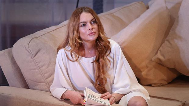 Lindsay Lohan at a photocall for Speed The Plow at London's Playhouse Theatre (AP)