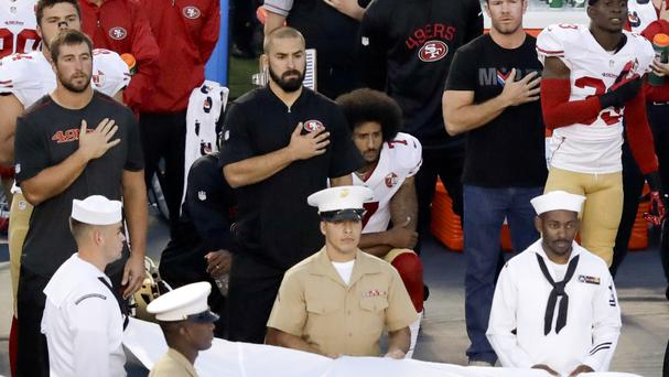 San Francisco 49ers quarterback Colin Kaepernick, centre, kneels during the national anthem before an NFL pre-season football game against the San Diego Chargers (AP)
