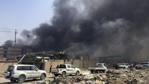 Smoke rises after explosions in eastern Baghdad (AP)