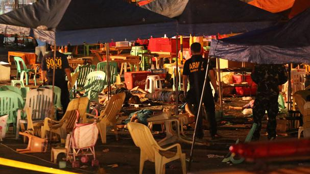 Philippine police officers at the scene of the blast