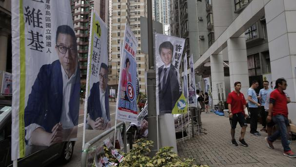 Election banners are displayed near a polling station in Hong Kong (AP)