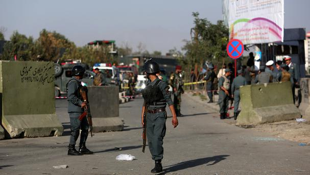 Afghan police inspect at the site of suicide attack near the Afghan Defence Ministry in Kabul (AP)