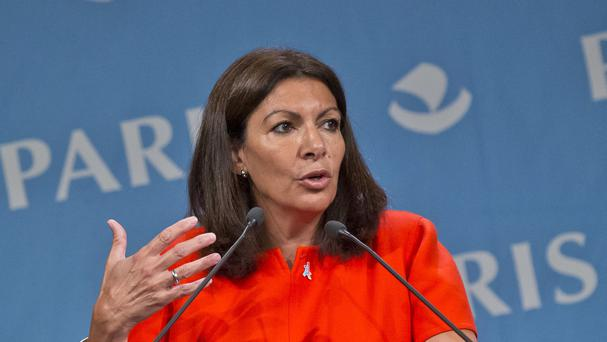 Mayor of Paris Anne Hidalgo hopes to open a refugee centre in the capital (AP)