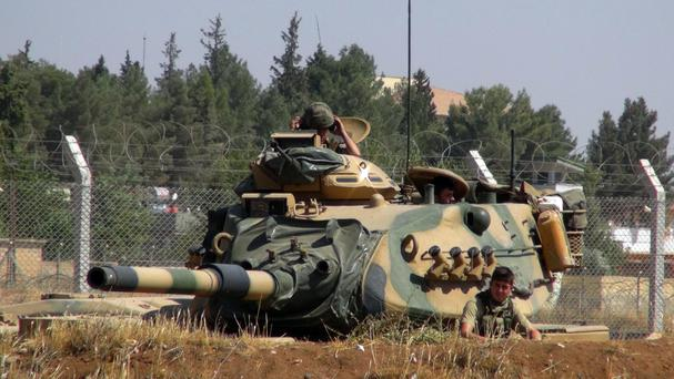 A Turkish army tank stationed near the Syrian border, in Suruc (AP)