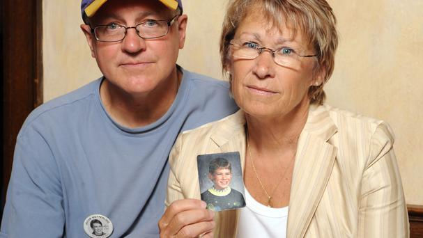 Patty and Jerry Wetterling with a photo of their son Jacob, who was abducted in October 1989 (AP)