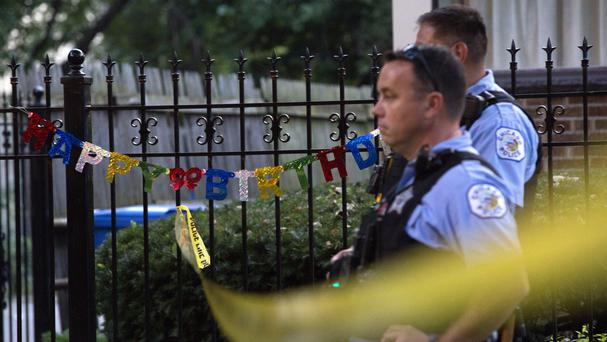 Police at the scene of a shooting in the Back of the Yards neighbourhood of Chicago (Chicago Tribune/AP)