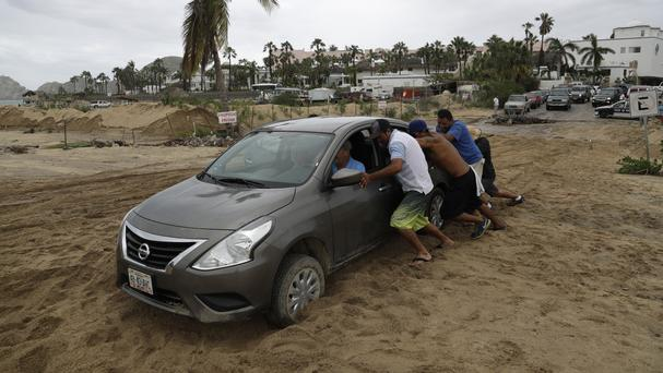 A car stranded in the sand after the passing of Hurricane Newton in Cabo San Lucas (AP)