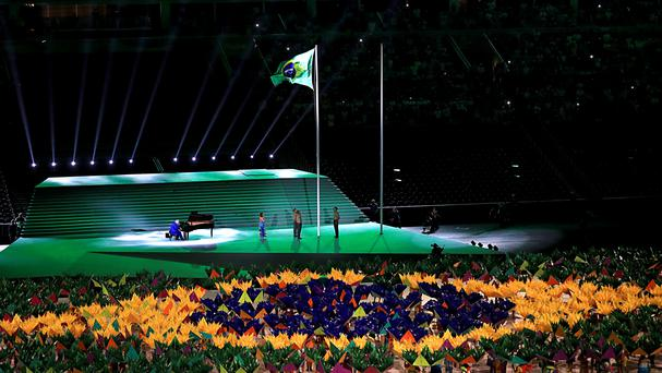 The Brazilian national anthem is played as the flag is raised during the opening ceremony of the Paralympic Games