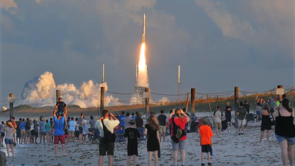 Hundreds of people watch from Canaveral National Seashore (Florida Today/AP)