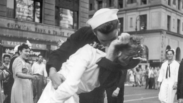 A sailor and a nurse kiss passionately in Manhattan's Times Square as New York City celebrates the end of the Second World War (US Navy/AP)