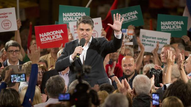 Zoran Milanovic, leader of the centre-left coalition, greets supporters at a rally in Zagreb ahead of the election