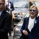 Hillary Clinton leaves her daughter's apartment building in New York (AP)