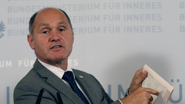 Austrian Interior Minister Wolfgang Sobotka attends a press conference in Vienna (AP)