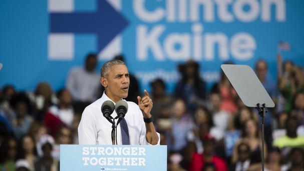 Barack Obama speaks at a campaign event for Democratic presidential candidate Hillary Clinton (AP)