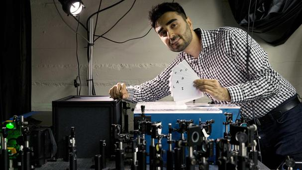 Barmak Heshmat poses with his prototype scanning device (AP)
