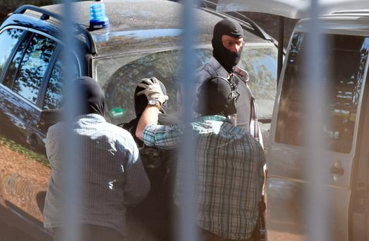 A man suspected of being an Islamic State (IS) militant arrives at the Federal Supreme Court in Karlsruhe, southern Germany. Photo: AFP/Getty Images