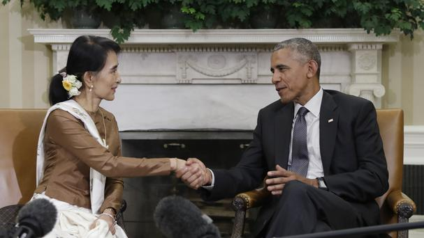 US president Barack Obama and Burmese leader Aung San Suu Kyi shake hands as they speak to media at the conclusion of a meeting in the Oval Office (AP)