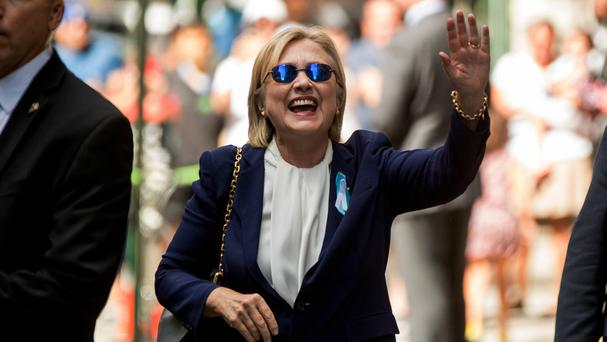 Hillary Clinton waves after leaving an apartment building in New York on September 11 (AP)