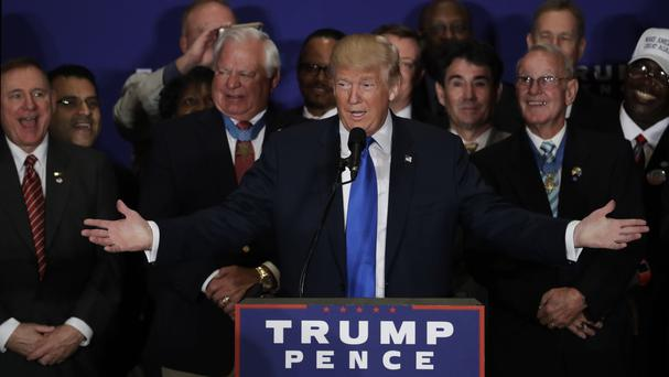 Republican presidential candidate Donald Trump speaking at one of his hotels (AP)