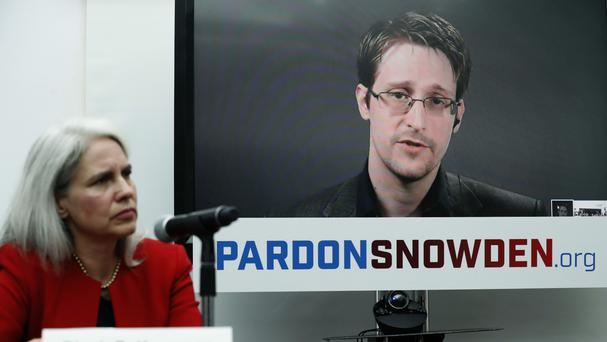 Dinah PoKempner general council for Human Rights Watch, listens as Edward Snowden speaks via video link from Moscow (AP)
