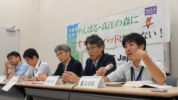 Japan's defence ministry officials answer questions from a group of protesters who oppose US military proposals (AP)