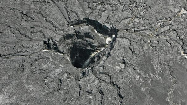 This aerial photo shows a massive sinkhole in Mulberry that opened up underneath a gypsum stack at a Mosaic phosphate fertiliser plant (Tampa Bay Times/AP)