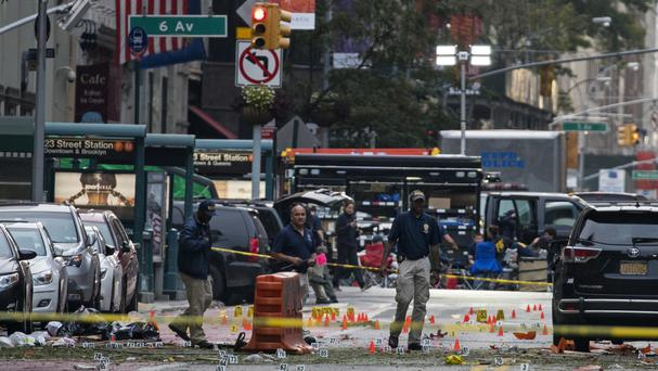 Investigators at the scene of Saturday's explosion in Manhattan's Chelsea neighbourhood in New York (AP)