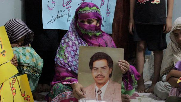 Safia Bano with a picture of her husband Imdad Ali (AP)