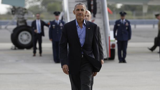 President Barack Obama arrives in New York for a Democratic Party fundraising event (AP)