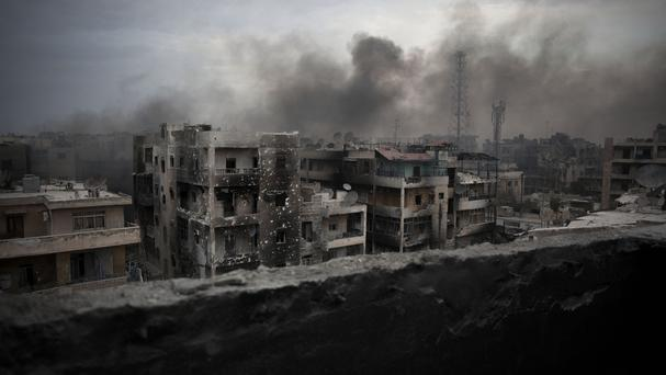 Rebel-held parts of Aleppo have been targeted in aerial attacks (AP)
