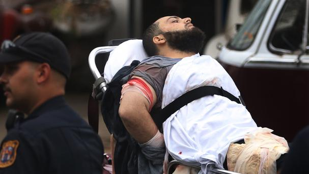 Ahmad Khan Rahami is taken into custody after the shoot-out (NJ Advance Media/AP)