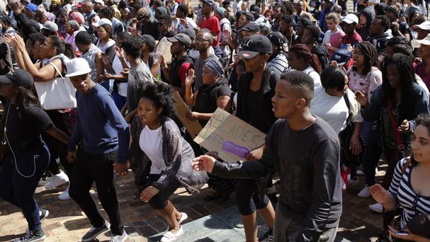 Students chant and sing at the University of Cape town as they protest for free education (AP)