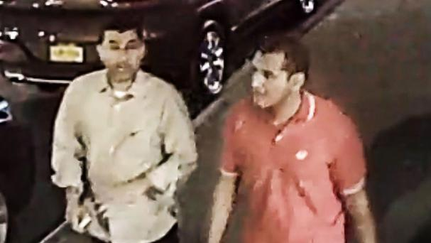 Video grab provided by the FBI showing two men walking in the Chelsea district of New York