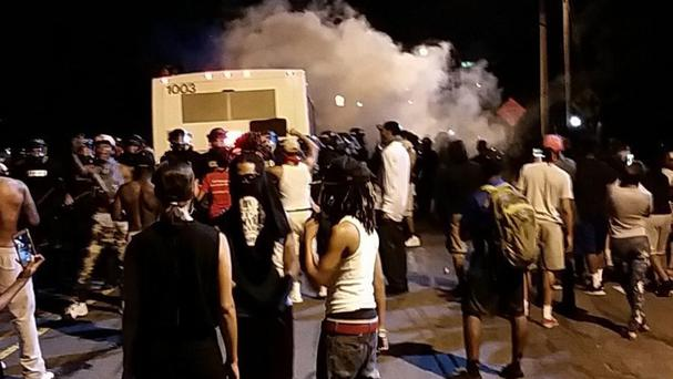 Police fire tear gas into the crowd of protesters in Charlotte, North Carolina (Charlotte Observer/AP)