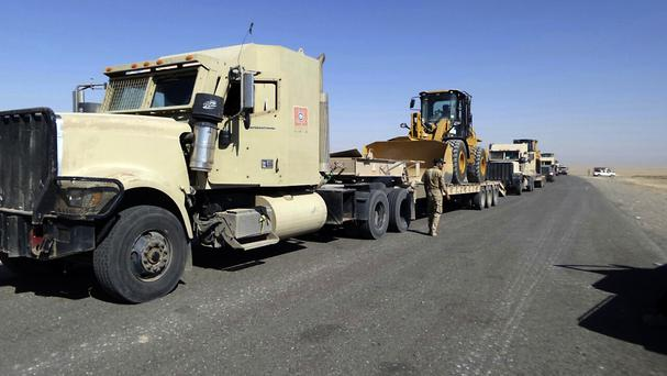 Iraqi security forces stationed outside the city of Shirqat near Mosul, Iraq (AP)