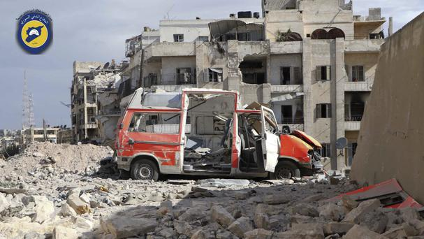 A destroyed ambulance outside the man Syrian Civil Defence centre after air strikes in Ansari (Syrian Civil Defence White Helmets/AP)