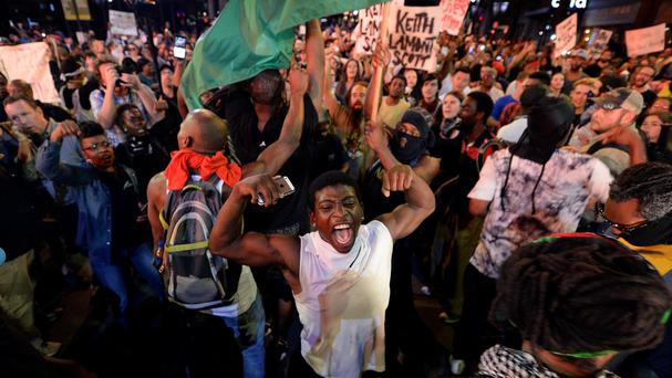 Protesters gather in Charlotte on a night of mostly peaceful protests over the shooting of Keith Lamont Scott (Charlotte Observer/AP)