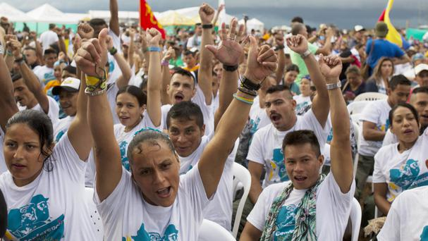 Rebels cheer during the closing event of the 10th conference of the Revolutionary Armed Forces of Colombia (AP)