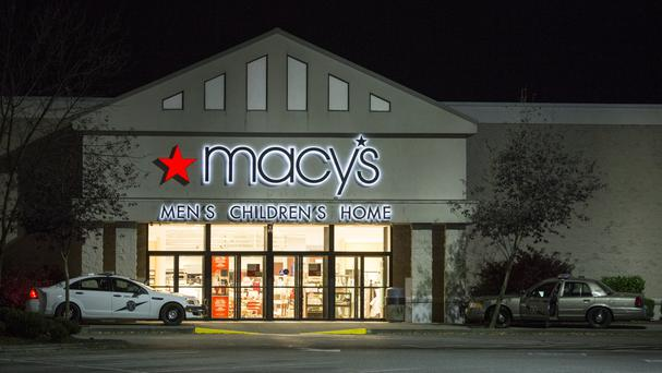 Law enforcement investigate a deadly shooting in the Macy's store at the Cascade Mall in Burlington (AP)