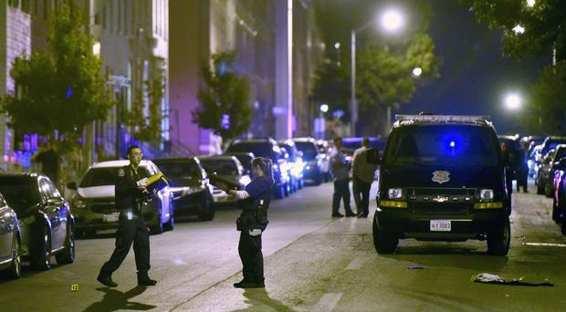 Police investigate the scene of the multiple shooting (AP)