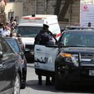 An ambulance transports the body of Jordanian writer Nahed Hattar to a medical facility, after he was shot, in Amman (AP)