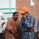 A family member of an injured passenger cries outside the Teaching hospital in Kathmandu (AP)