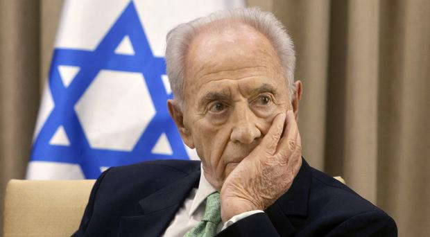 Shimon Peres pictured in 2013 - media in Israel are reporting that the the former president has died following a stroke (AP)