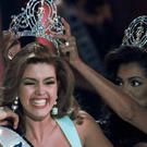 The 1996 Miss Universe, Alicia Machado of Venezuela, is crowned by the 1995 winner Chelsi Smith in Las Vegas (AP)