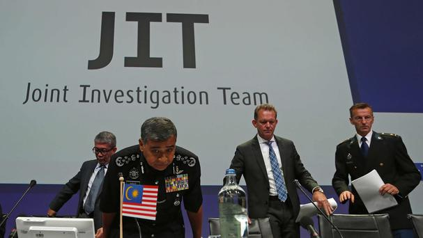 The Joint Investigation Team take their seats for a press conference on the preliminary results of the investigation into the shooting-down of Malaysia Airlines jetliner flight MH17 (AP)