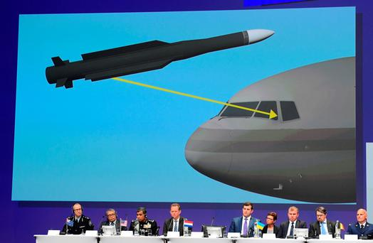 Members of a joint investigation team present the results of the criminal investigation into the downing of Malaysia Airlines flight MH17, in Nieuwegein, Netherlands, yesterday. Picture: Getty