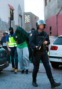 A suspect is held by Spanish police in Melilla. Picture: Getty