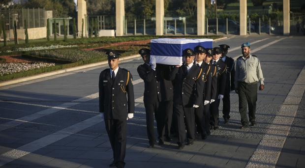 Members of the Knesset guard carry the coffin of former Israeli president Shimon Peres to his lying in state (AP)